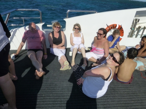Catching some rays on the front on the boat before the ride home